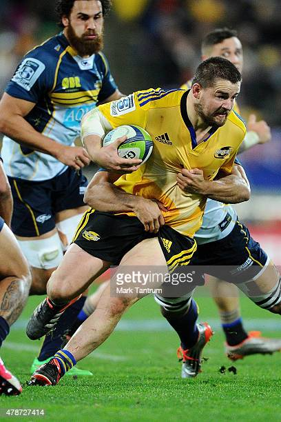 Brad Shields pushes through tackles during the Super Rugby Semi Final match between the Hurricanes and the Brumbies at Westpac Stadium on June 27...