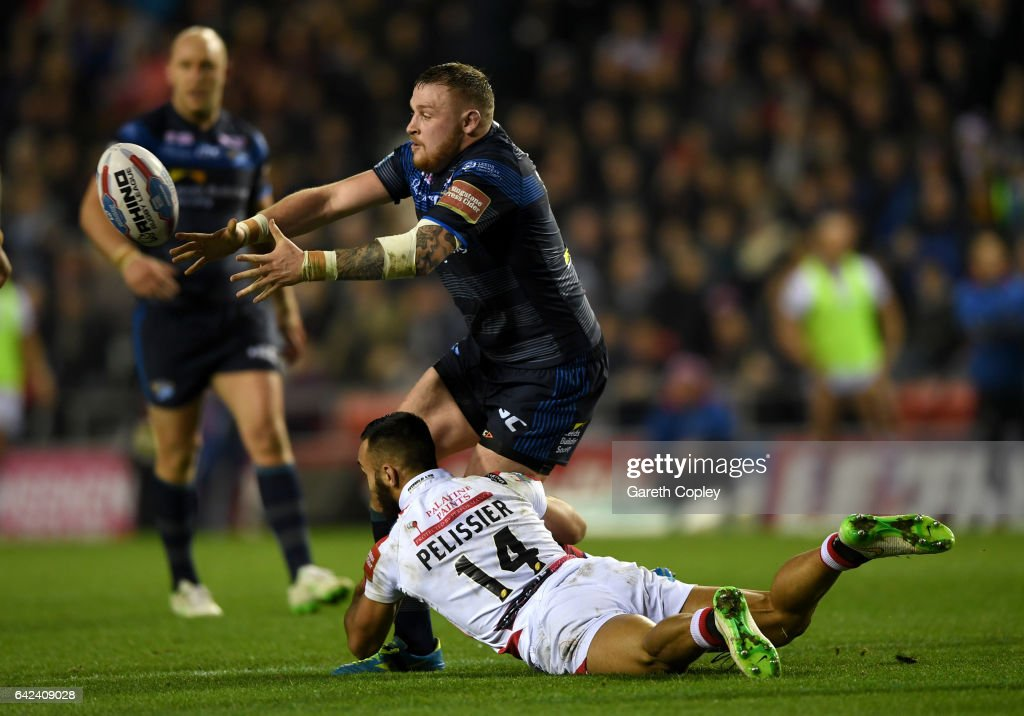 Brad Singleton of Leeds gets past Eloi Pelissier of Leigh during the Betfred Super League match between Leigh Centurions and Leeds Rhinos at Leigh Sports Village on February 17, 2017 in Leigh, Greater Manchester.