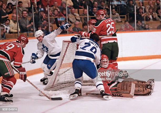Brad Smith and Wendel Clark of the Toronto Maple Leafs skate against Rich Preston Dave Lewis and Alain Chevrier of the New Jersey Devils during NHL...
