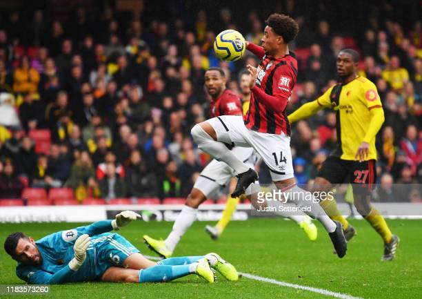 Brad Smith of AFC Bournemouth misses a chance under pressure from Ben Foster of Watford during the Premier League match between Watford FC and AFC...