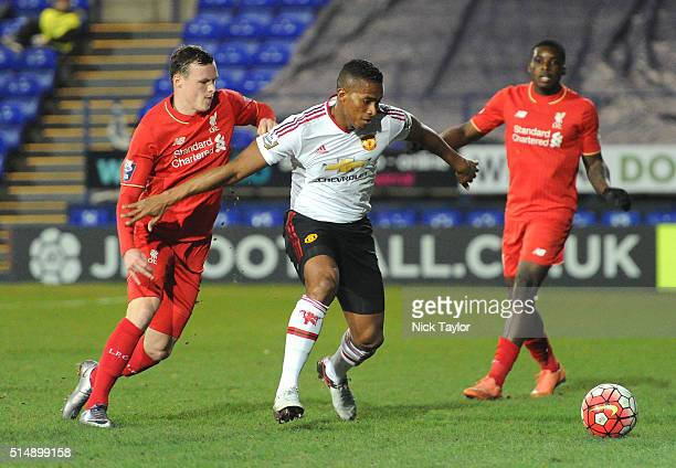 Brad Smith of Liverpool and Antonio Valencia of Manchester United in action during the Liverpool v Manchester United U21 Premier League game at...
