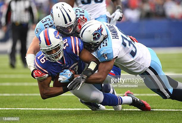 Brad Smith of the Buffalo Bills is tackled during their NFL game by Chris Hawkins and Colin McCarthy of the Tennessee Titans at Ralph Wilson Stadium...