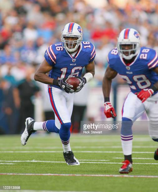 Brad Smith of the Buffalo Bills runs with blocking from CJ Spiller of the Buffalo Bills at Ralph Wilson Stadium on August 27 2011 in Orchard Park New...
