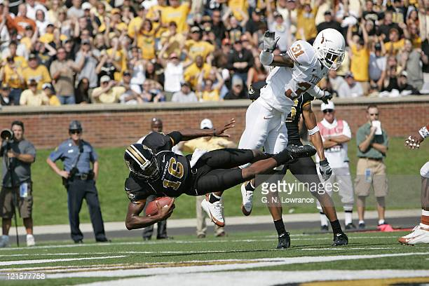 Brad Smith of the Missouri Tigers dives in for a touchdown during a game against the Texas Longhorns at Memorial Stadium in Columbia Missouri on...