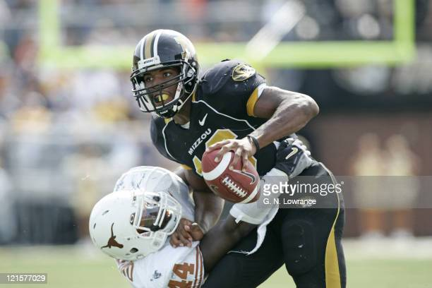Brad Smith of the Missouri Tigers tries to break free from a tackle during a game against the Texas Longhorns at Memorial Stadium in Columbia...
