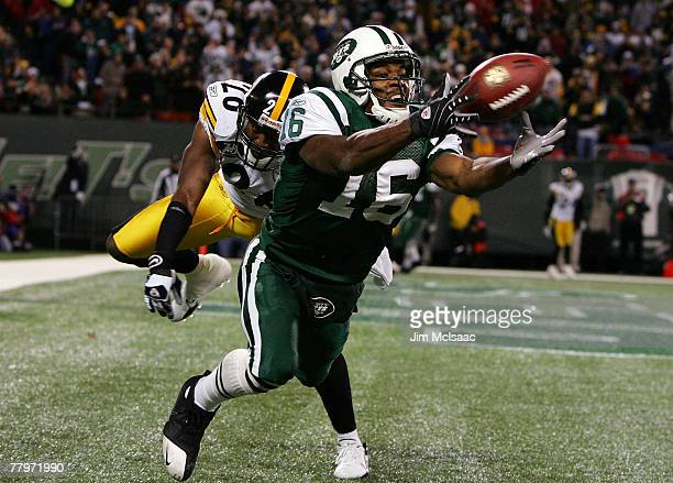 Brad Smith of the New York Jets can't hold on to the ball in the endzone late in the fourth quarter as Deshea Townsend of the Pittsburgh Steelers...