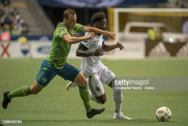 Brad Smith of the Seattle Sounders and Alphonso Davies of the Vancouver Whitecaps at BC Place on September 15 2018 in Vancouver Canada