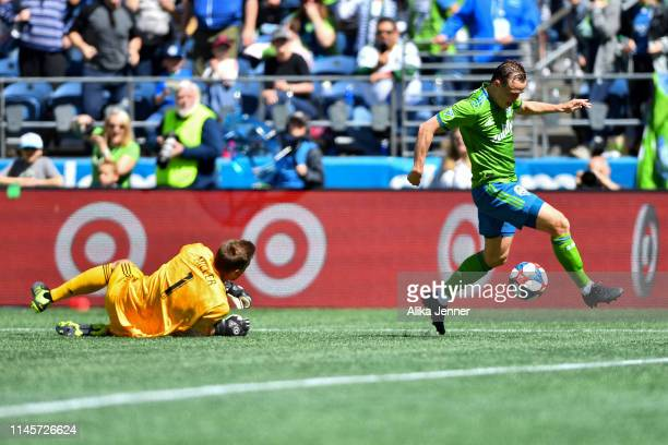 Brad Smith of the Seattle Sounders gets past a diving Tyler Miller of the Los Angeles FC during the second half of the match at CenturyLink Field on...