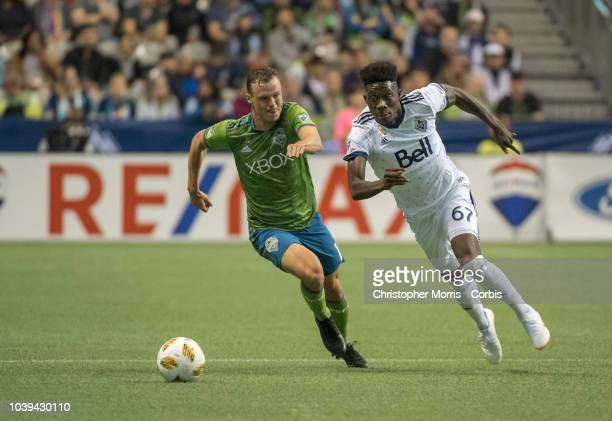Brad Smith of the Seattle Sounders pursues Alphonso Davies of the Vancouver Whitecaps at BC Place on September 15 2018 in Vancouver Canada