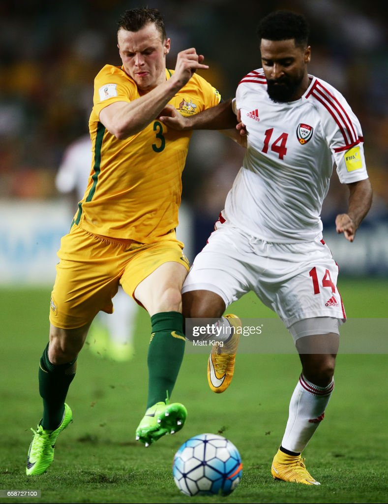 Brad Smith of the Socceroos competes for the ball against Abdelaziz Sanqour of the United Arab Emirates during the 2018 FIFA World Cup Qualifier match between the Australian Socceroos and United Arab Emirates at Allianz Stadium on March 28, 2017 in Sydney, Australia.