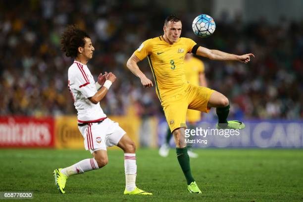 Brad Smith of the Socceroos is challenged by Mohamed Alraqi of the United Arab Emirates during the 2018 FIFA World Cup Qualifier match between the...