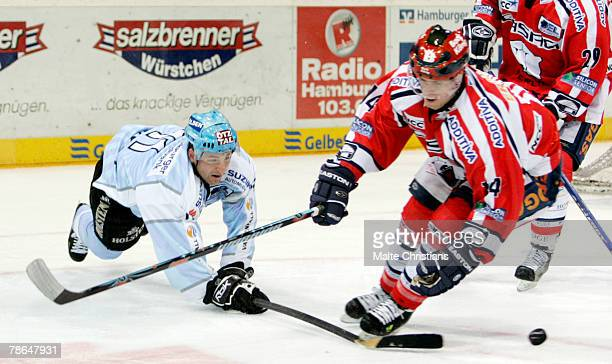 Brad Smyth of Hamburg competes with Andre Rankel of Berlin during the DEL match between Hamburg Freezers and Eisbaeren Berlin at the Color Line Arena...