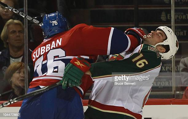 Brad Staubitz of the Minnesota Wild is hit by PK Subban of the Montreal Canadiens at the Bell Centre on September 26 2010 in Montreal Canada The...