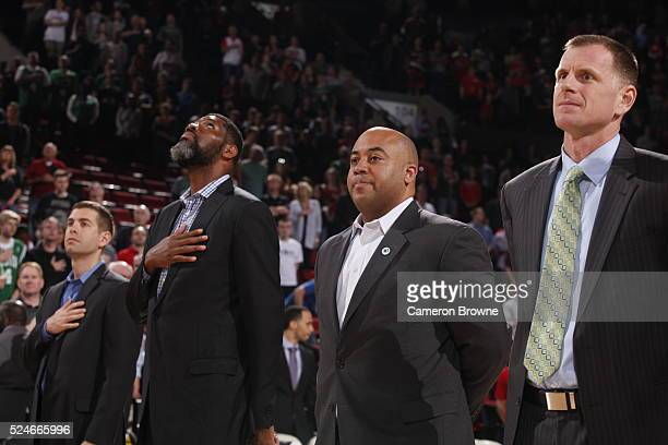 Brad Stevens of the Boston Celtics and the assistant coaches Walter McCarty Micah Shrewsberry and Jay Larranaga stand for a moment of silence for the...