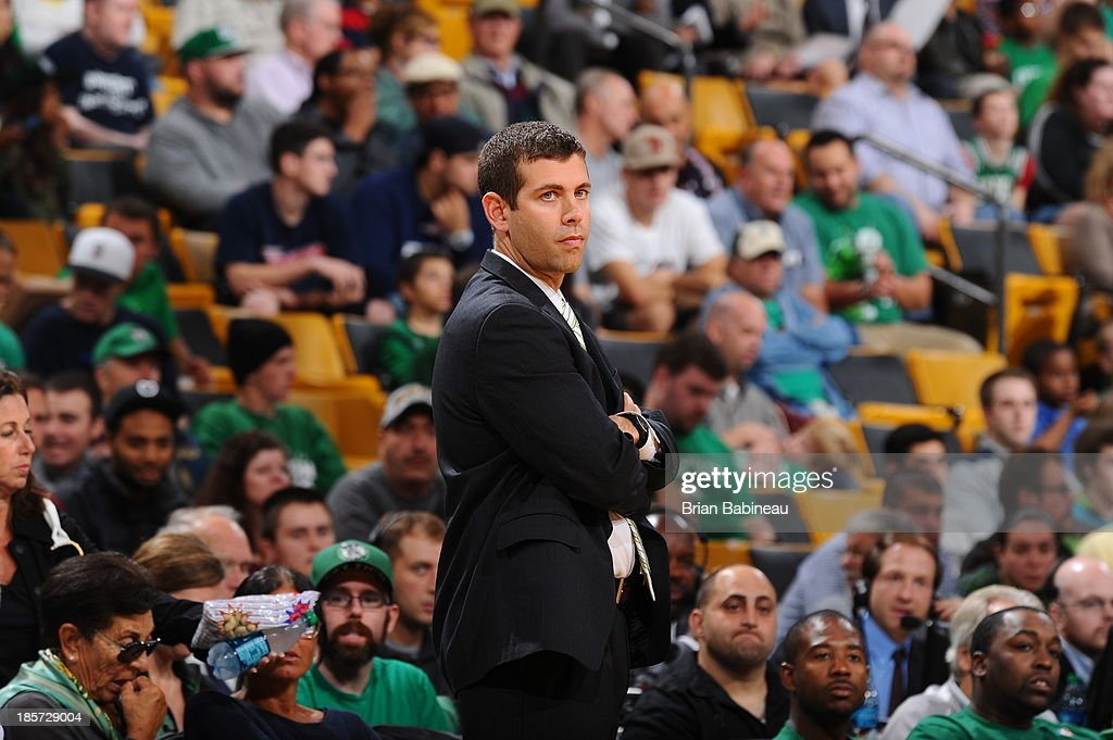 Brad Stevens of the Boston Celtics coaches during the game against the Toronto Raptors on October 7, 2013 at the TD Garden in Boston, Massachusetts.