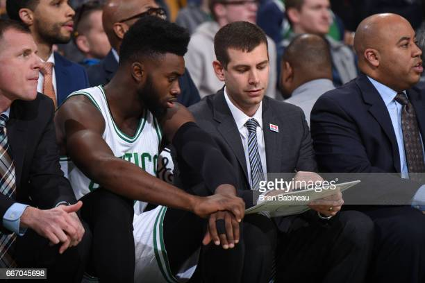 Brad Stevens of the Boston Celtics goes over the next play with Jaylen Brown of the Boston Celtics during the game against the Indiana Pacers on...