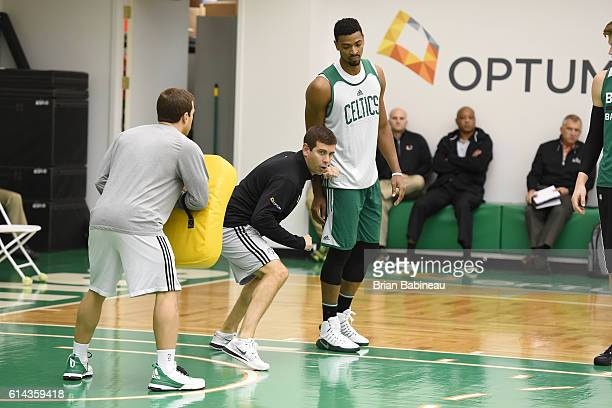 Brad Stevens of the Boston Celtics post up against Jordan Mickey during practice on October 11 2016 at the Boston Celtics Training facility in...