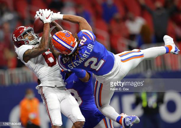 Brad Stewart Jr. #2 and Donovan Stiner of the Florida Gators break up this touchdown reception intended for DeVonta Smith of the Alabama Crimson Tide...