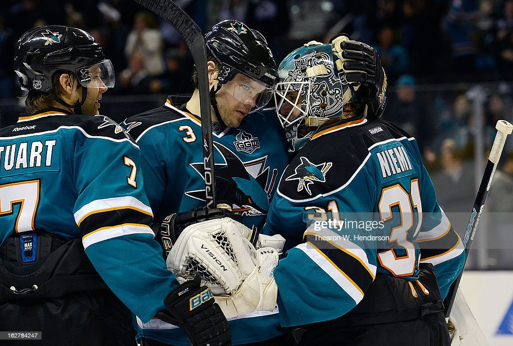 Brad Stuart #7 and Douglas Murray #3 of the San Jose Sharks congratulates goalkeeper Antti Niemi #31 after the Sharks defeated the Colorado Avalanche 3-2 in an overtime shoot-out at HP Pavilion on February 26, 2013 in San Jose, California.