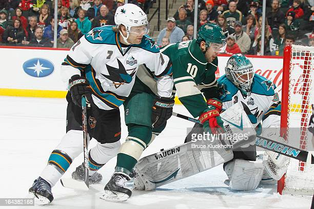 Brad Stuart and goalie Antti Niemi of the San Jose Sharks defend their goal against Devin Setoguchi of the Minnesota Wild during the game on March 23...