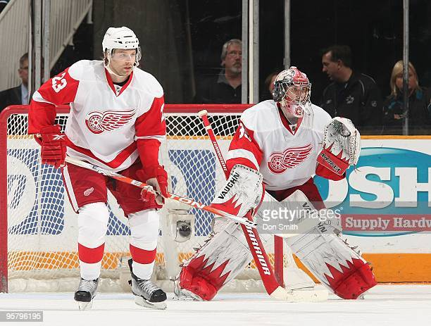 Brad Stuart and Jimmy Howard of the Detroit Red Wings defend the net during an NHL game against the San Jose Sharks on January 9, 2010 at HP Pavilion...