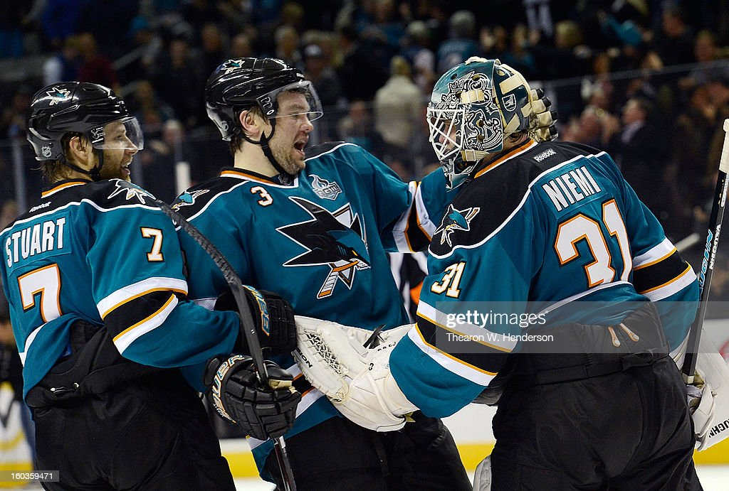 Brad Stuart #7, Douglas Murray #3 and Antti Niemi #31 of the San Jose Sharks celebrates after they defeated the Anaheim Ducks 3-2 in an overtime shoot-out at HP Pavilion on January 29, 2013 in San Jose, California.