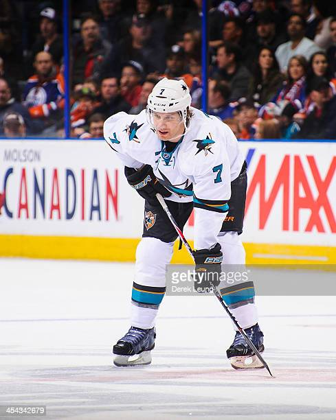Brad Stuart of the San Jose Sharks skates against the Edmonton Oilers during an NHL game at Rexall Place on November 15 2013 in Edmonton Alberta...