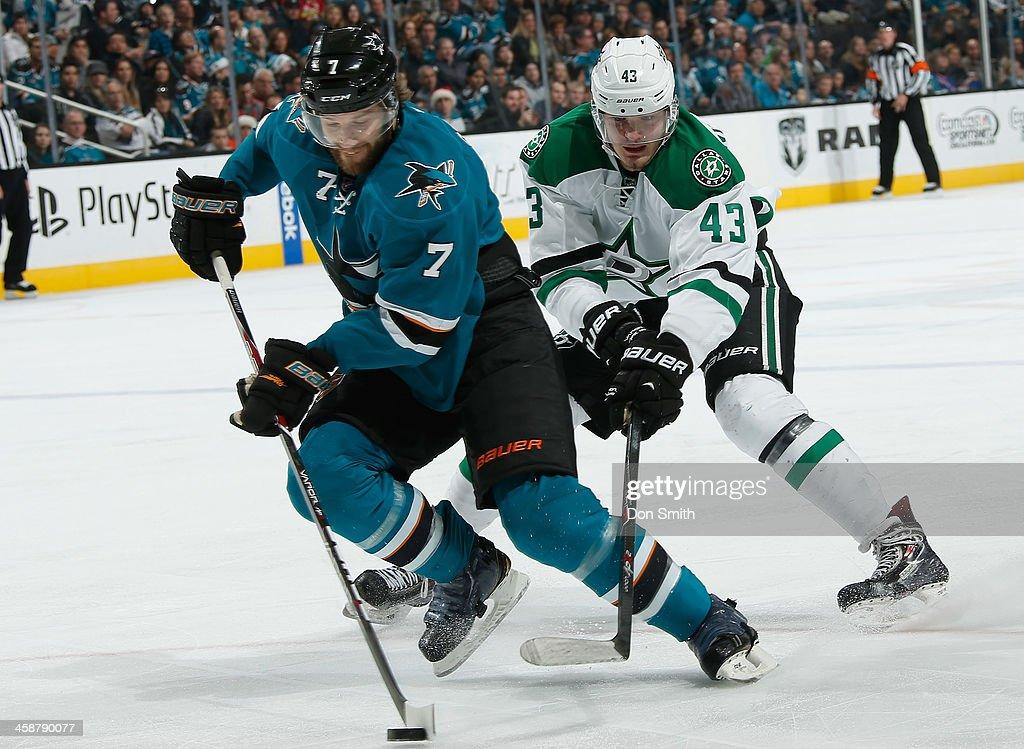 Brad Stuart #7 of the San Jose Sharks skates up the ice against Valeri Nichushkin #43 of the Dallas Stars during an NHL game on December 21, 2013 at SAP Center in San Jose, California.