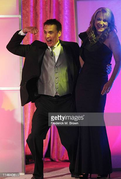 Brad Sutter and actress Megyn Price on stage during the 36th Annual Gracie Awards Gala at the Beverly Hilton Hotel on May 24 2011 in Beverly Hills...