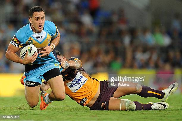 Brad Takairangi if the Titans is tackled during the round 6 NRL match between the Gold Coast Titans and the Brisbane Broncos at Cbus Super Stadium on...