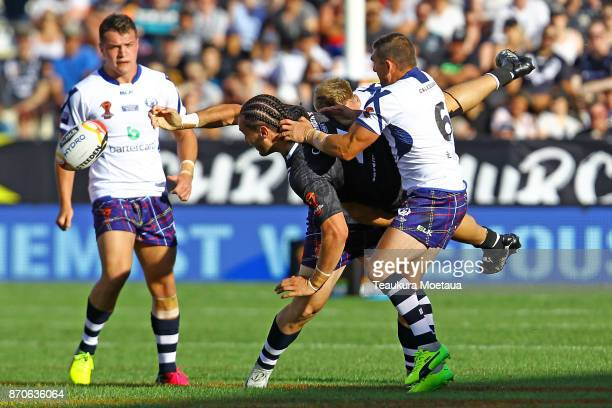 Brad Takairangi of New Zealand offloads the ball during the 2017 Rugby League World Cup match between the New Zealand Kiwis and Scotland at AMI...