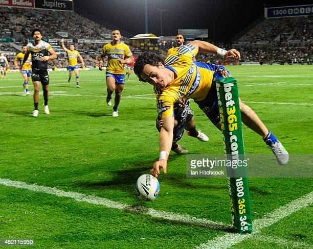 Brad Takairangi of the Eels drops the ball as he attepts to score a try during the round 20 NRL match between the North Queensland Cowboys and the...