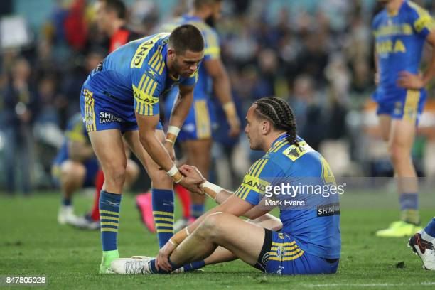 Brad Takairangi of the Eels is consoled by Will Smith after Parramatta's loss during the NRL Semi Final match between the Parramatta Eels and the...