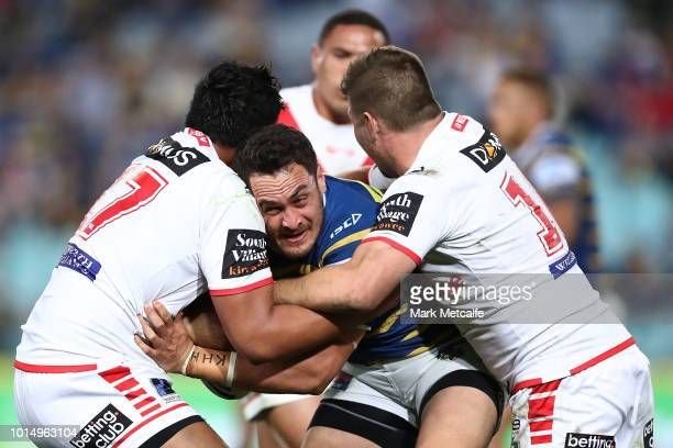 Brad Takairangi of the Eels is tackled during the round 22 NRL match between the Parramatta Eels and the St George Illawarra Dragons at ANZ Stadium...