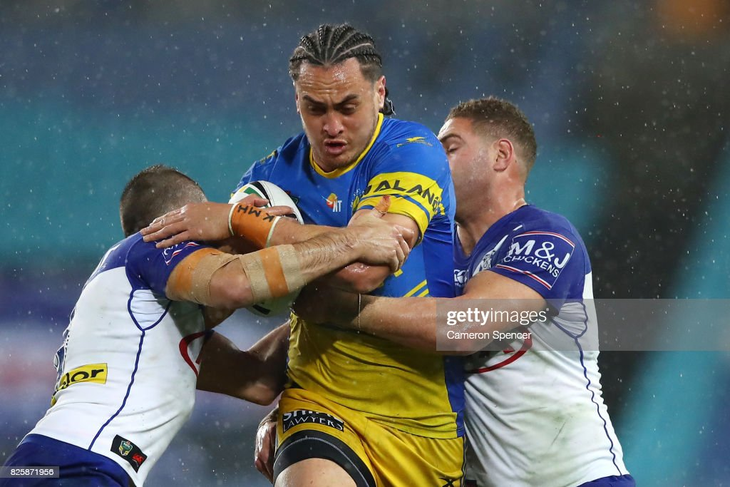 Brad Takairangi of the Eels is tackled during the round 22 NRL match between the Canterbury Bulldogs and the Parramatta Eels at ANZ Stadium on August 3, 2017 in Sydney, Australia.