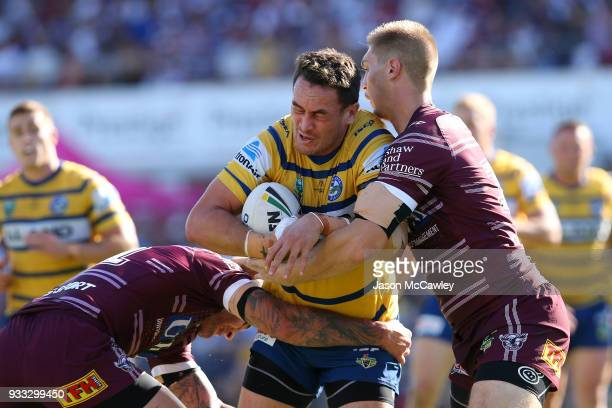 Brad Takairangi of the Eels is tackled during the round two NRL match between the Manly Sea Eagles and the Parramatta Eels at Lottoland on March 18...