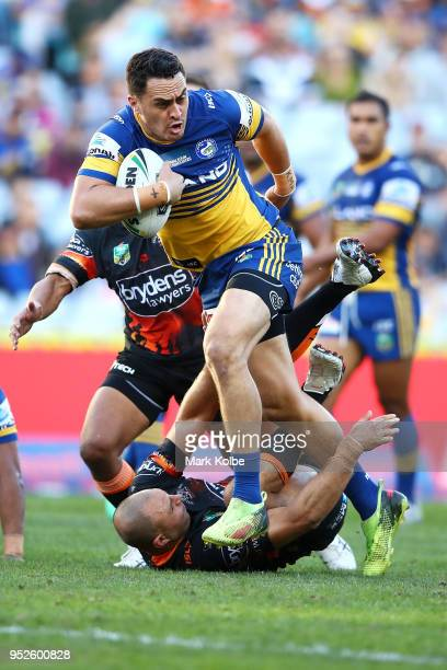 Brad Takairangi of the Eels makes a break during the round Eight NRL match between the Parramatta Eels and the Wests Tigers at ANZ Stadium on April...