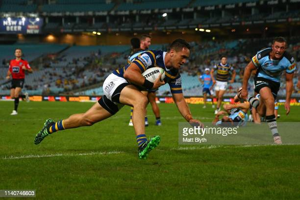 Brad Takairangi of the Eels scores a try during the round four NRL match between the Parramatta Eels and the Cronulla Sharks at ANZ Stadium on April...