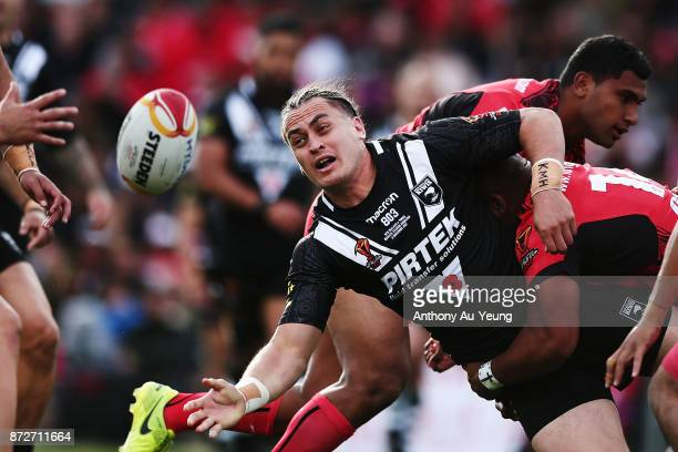 Brad Takairangi of the Kiwis offloads in a tackle during the 2017 Rugby League World Cup match between the New Zealand Kiwis and Tonga at Waikato...