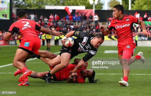 Brad Takairangi of the Kiwis offloads the ball during the 2017 Rugby League World Cup match between the New Zealand Kiwis and Tonga at Waikato...