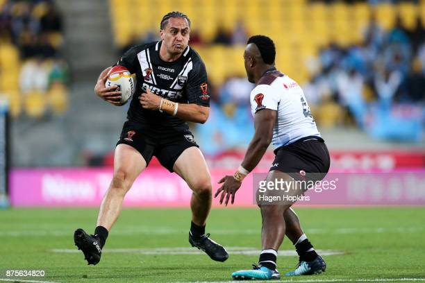 Brad Takairangi of the Kiwis runs at Akuila Uate of Fiji during the 2017 Rugby League World Cup Quarter Final match between New Zealand and Fiji at...