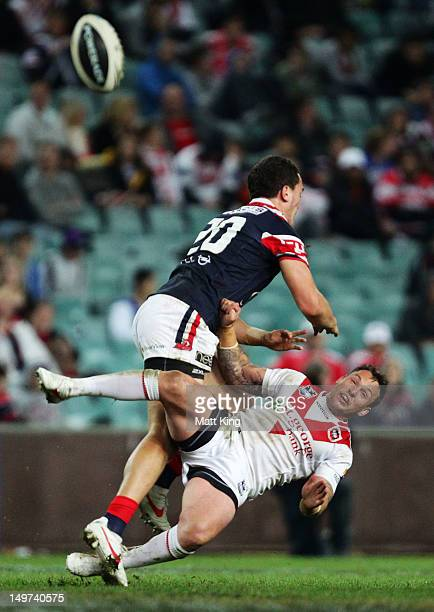 Brad Takairangi of the Roosters makes a late hit on Nathan Fien of the Dragons which led the second try by Mitchell Pearce during the round 22 NRL...