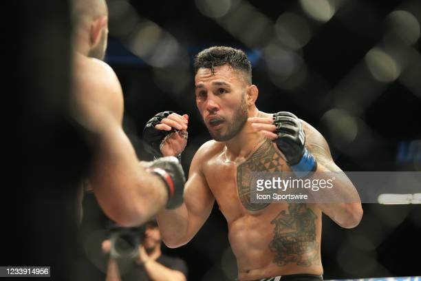 Brad Tavares battles Omari Akhmedov in their UFC middleweight bout during UFC 264 at T-Mobile Arena on July 10 in Las Vegas, Nevada, United States.
