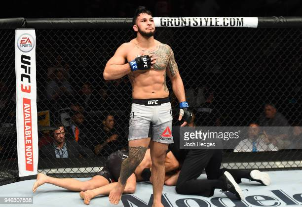 Brad Tavares celebrates his victory over Krzysztof Jotko of Poland in their middleweight fight during the UFC Fight Night event at the Gila Rivera...