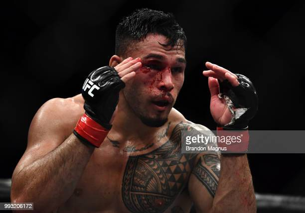 Brad Tavares circles Israel Adesanya of Nigeria in their middleweight bout during The Ultimate Fighter Finale event inside The Pearl concert theater...