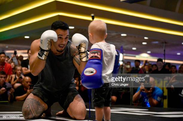Brad Tavares interacts with a young fan during the UFC 226 and The Ultimate Fighter Finale Open Workouts at MGM Grand Hotel & Casino on July 4, 2018...