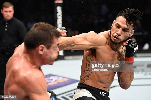 Brad Tavares punches Caio Magalhaes of Brazil in their middleweight bout during the UFC 203 event at Quicken Loans Arena on September 10, 2016 in...