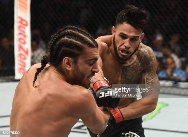 Brad Tavares punches Elias Theodorou of Canada in their middleweight bout during The Ultimate Fighter Finale at T-Mobile Arena on July 7, 2017 in Las...