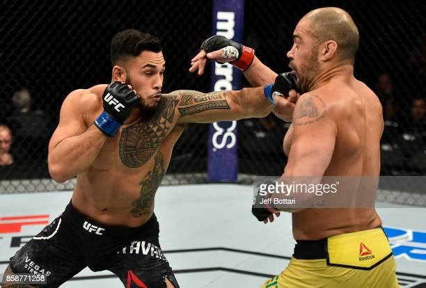 Brad Tavares punches Thales Leites of Brazil in their middleweight bout during the UFC 216 event inside T-Mobile Arena on October 7, 2017 in Las...