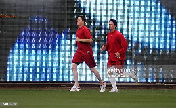 Brad Thompson and Randy Flores of the St Louis Cardinals jog in the outfield before a game against the Milwaukee Brewers on April 30 2007 at Miller...